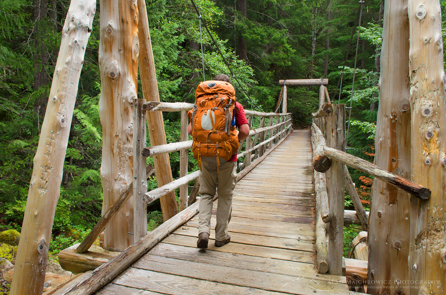 Hiker on suspension bridge Suiattle River Trail North Cascades