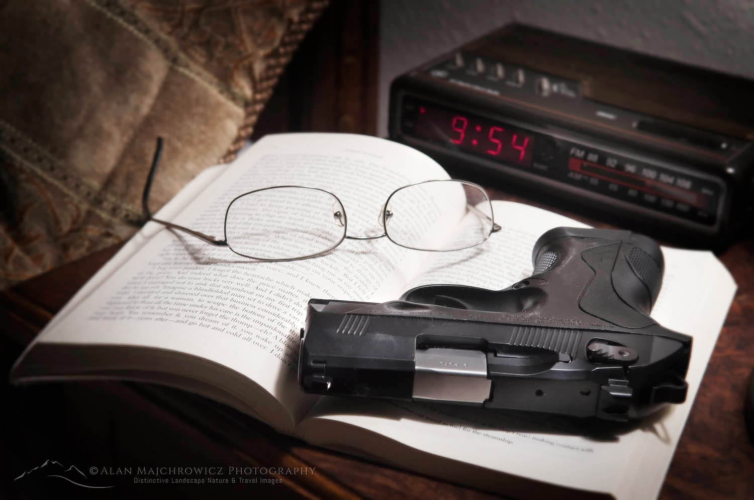 Beretta PX4 Storm semi-automatic pistol with 9mm ammunition on bedroom nightstand