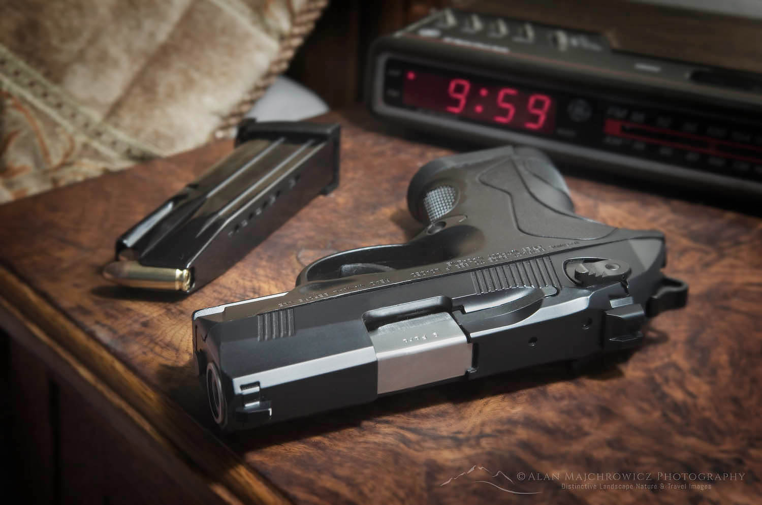 Beretta 9mm PX4 Storm semi-automatic pistol home defense. On bedside nightstand with book and reading glasses
