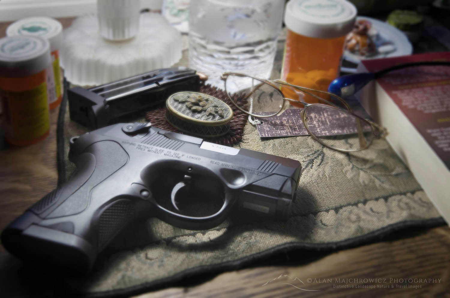 Beretta PX4 Storm semi-automatic pistol with 9mm ammunition on bedroom nightstand with prescription medication