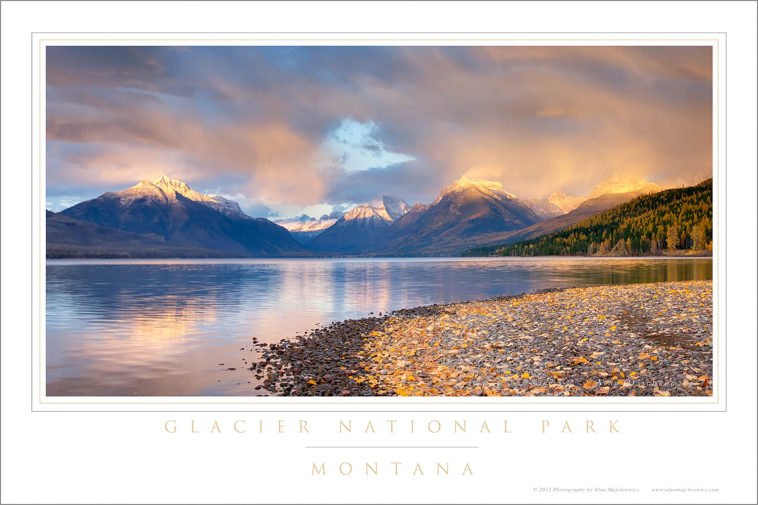 Fallen leaves line the shore of Lake McDonald as a passing storm glows in the evening light, Glacier National Park